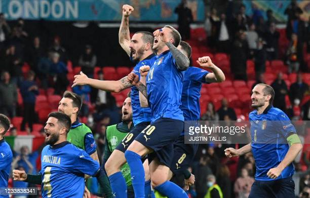 Italy's players celebrate after winning the UEFA EURO 2020 semi-final football match between Italy and Spain at Wembley Stadium in London on July 6,...
