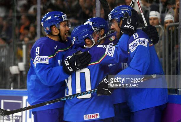 Italy´s players celebrate during the IIHF Ice Hockey World Championships first round match between Italy and Latvia in Cologne western Germany on May...