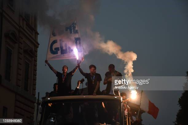 Italy's players celebrate on an open double decker in downtown Rome, Italy on July 12 after their victory of the UEFA EURO 2020 football tournament...