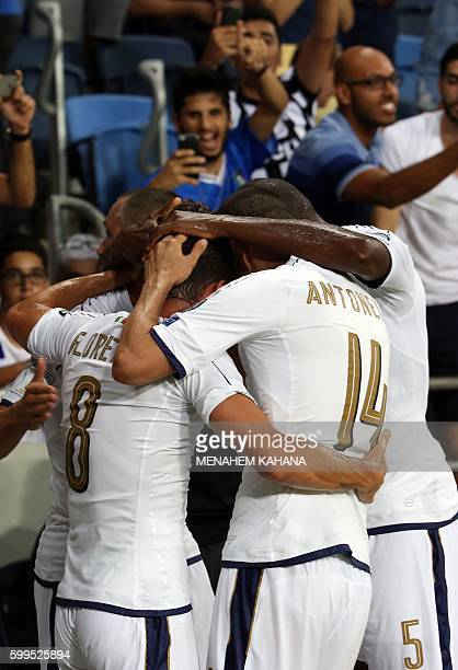 Italy's players celebrate scoring their third goal during the Wolrd Cup 2018 qualifying football match between Israel and Italy at Sammy Ofer Stadium...