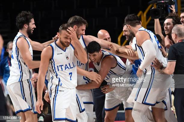 Italy's players celebrate their victory at the end of the men's preliminary round group B basketball match between Italy and Nigeria during the Tokyo...