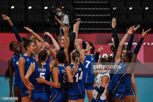 Italy's players celebrate their victory in the women's preliminary round pool B volleyball match between Russia and Italy during the Tokyo 2020...