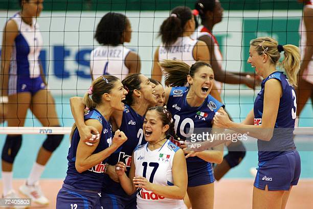 Italy's players celebrate their victory over Cuba in the women's first round Pool D match of the Volleyball World Championships in Nagoya central...