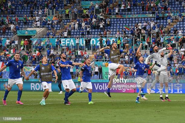 Italy's players celebrate their win in the UEFA EURO 2020 Group A football match between Italy and Wales at the Olympic Stadium in Rome on June 20,...