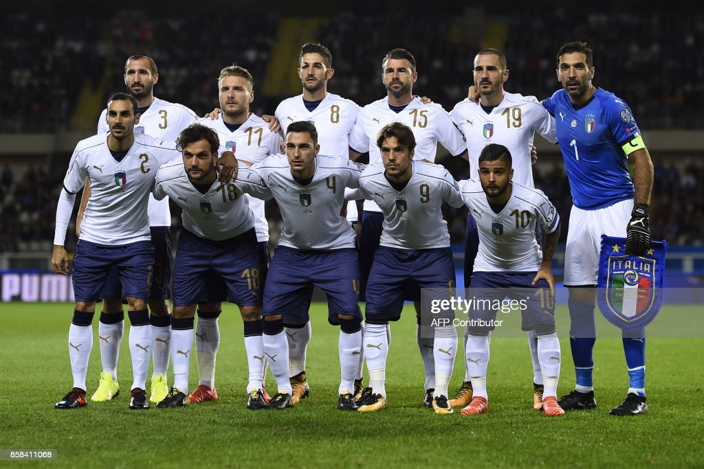 Italy's players (Front Row, From L) Davide Zappacosta, Marco Parolo, Matteo Darmian, Simone Verdi and Lorenzo Insigne and (Back Row, From L) Giorgio Chellini, Ciro Immobile, Roberto Gagliardini, Andrea Barzagli, Leonardo Bonucci and goalkeeper Gianluigi Buffon pose for a team photo prior to the FIFA World Cup 2018 qualification football match between Italy and Macedonia on October 6, 2017 at the Grande Torino Stadium in Turin. /