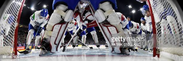 Italy´s players huddle together prior to the IIHF Ice Hockey World Championships first round match between USA and Italy in Cologne, western Germany...