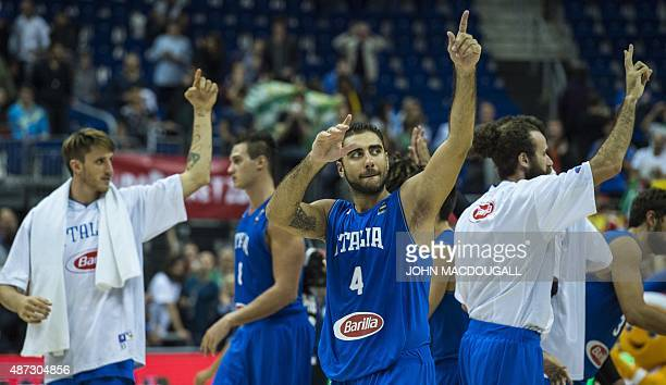 Italy's players including Pietro Aradori celebrate after defeating Spain in the EuroBasket group B match Spain vs Italy in Berlin September 8 2015...