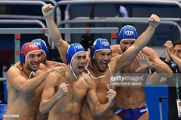 Italy's players jubilate after winning the Rio 2016 Olympic Games men's water polo semifinal match against Montenegro to get the bronze medal at the...