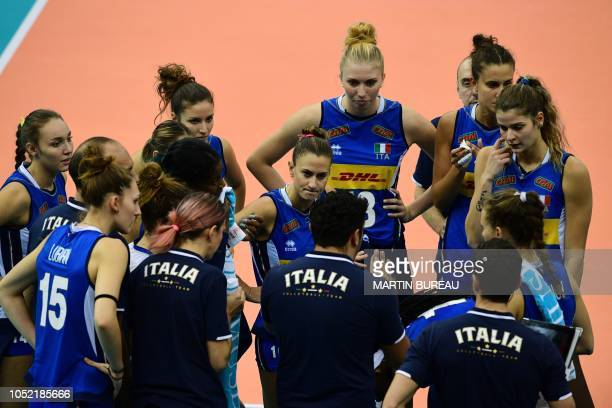 Italy's players listen to their coach during the 2018 FIVB World Championship volleyball women's pool G match between Italy and Japan in Nagoya on...