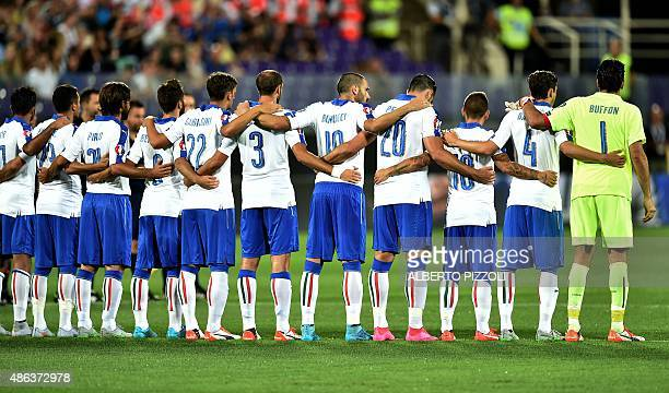 Italy's players observe a minute of silence to pay homage to the deceased of Europe's migrants crisis during the Euro 2016 group H qualifying...