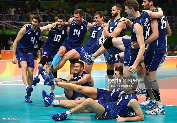 Italy's players pose as they celebrate after winning the men's quarterfinal volleyball match against Iran at Maracanazinho Stadium in Rio de Janeiro...