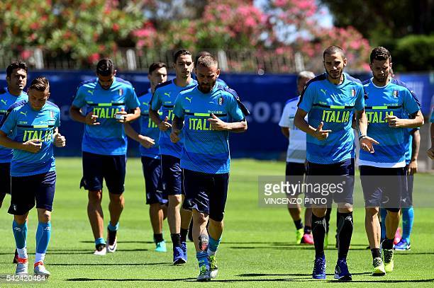 Italy's players run during a training session at their training ground in Montpellier on June 23 2016 during the Euro 2016 football tournament / AFP...