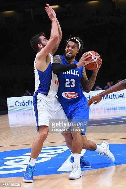 Italy's point guard Daniel Hackett holds on to the ball during the round of 16 basketball match between Israel and Italy at the EuroBasket 2015 in...