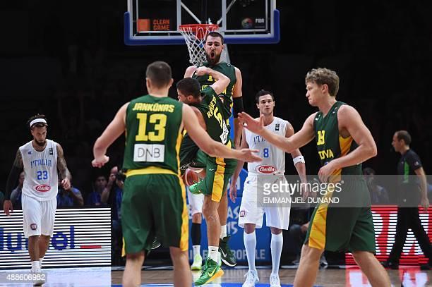 Italy's point guard Daniel Hackett Lithuania's power forward Paulius Jankunas Lithuania's point guard Mantas Kalnietis Lithuania's center Jonas...