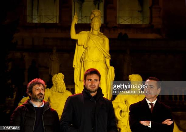 Italy's populist Five Star Movement party leader Luigi Di Maio and M5S members Roberto Fico and Alessandro Di Battista stand during the last election...
