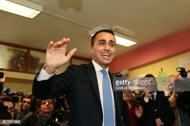 Italy's populist Five Star Movement party leader Luigi Di Maio arrives to vote for general elections on March 4, 2018 at a polling station in Naples....