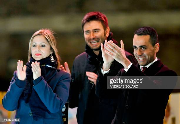 Italy's populist Five Star Movement party leader Luigi Di Maio claps next to M5S members Roberta Lombardi and Alessandro Di Battista at the end of...