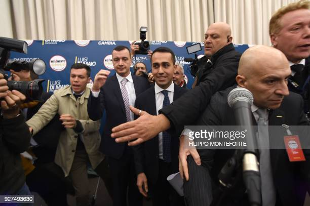 Italy's populist Five Star Movement party leader Luigi Di Maio is surrounded by bodyguards as he arrives to give a press conference a day after...