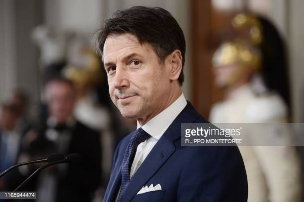 Italy's premierdesignate Giuseppe Conte reacts as he starts to read the list of his new cabinet after a meeting with Italian President at the Rome's...