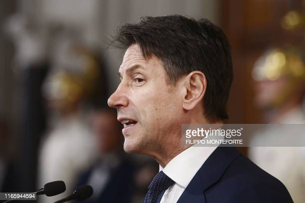 Italy's premierdesignate Giuseppe Conte reads the list of his new cabinet after a meeting with Italian President at the Rome's Quirinale Presidential...