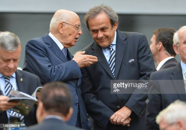 Italy's President Giorgio Napolitano chats with UEFA president Michel Platini during the Euro 2012 championships football match Spain vs Italy on...