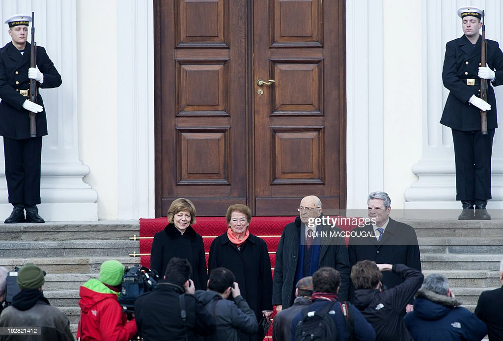 Italy's president Giorgio Napolitano (2ndR), his wife Clio (2ndL), German President Joachim Gauck and his partner Daniela Schadt pose for photographers at Bellevue palace on February 28, 2013 in Berlin during his visit in Germany. Napolitano has cancelled planned talks with the man bidding to unseat German Chancellor Angela Merkel after he called two of the candidates in Italian elections 'clowns.'