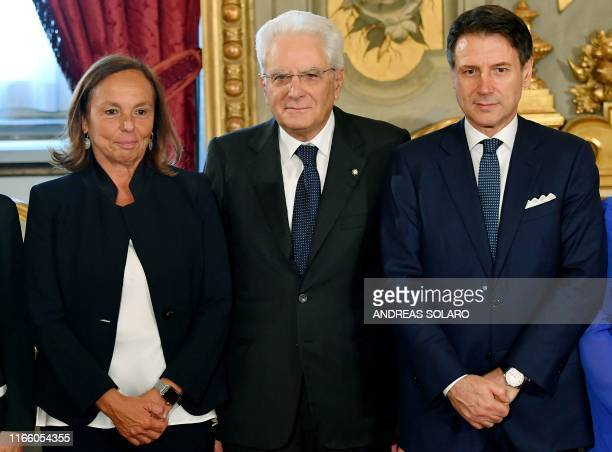 Italy's President Sergio Mattarella and Italy's Prime Minister Giuseppe Conte pose with Italy's Interior Minister Luciana Lamorgese during a...