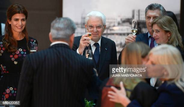 Italy's President Sergio Mattarella his daughter Laura Argentina's President Mauricio Macri and his wife the first lady Juliana Awada toast during...