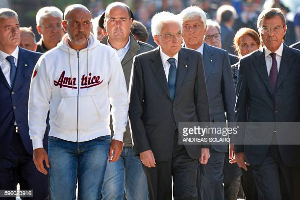 Italy's President Sergio Mattarella looks on as he walks next to mayor of Amatrice Sergio Pirozzi in the damaged central Italian village of Amatrice...