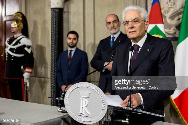 Italy's President Sergio Mattarella talks to journalists after Italy's designated Prime Minister Giuseppe Conte returned the mandate to form a new...