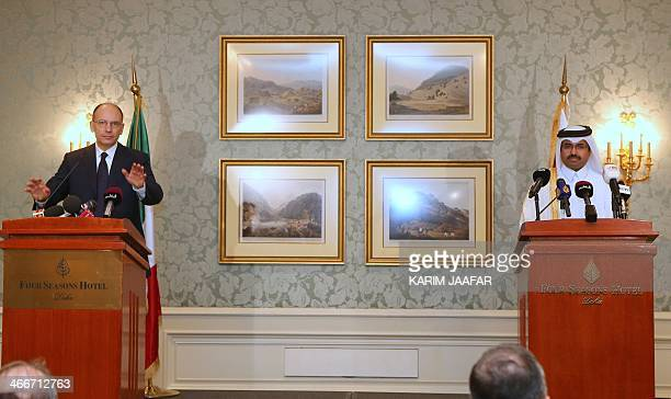 Italy's Prime Minister Enrico Letta speaks near Qatar's Minister of Energy and Industry Mohammed Saleh alSada during a press conference on February 3...
