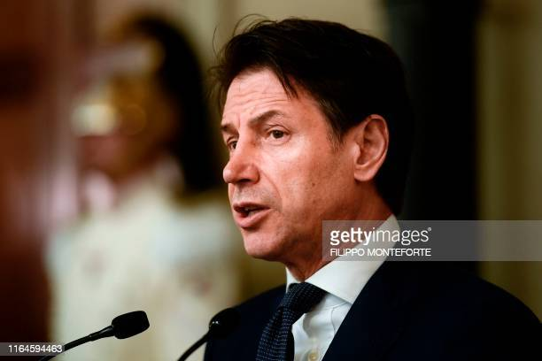 Italys Prime Minister Giuseppe Conte addresses the media following a meeting with the Italian president after he was given a mandate to form a new...