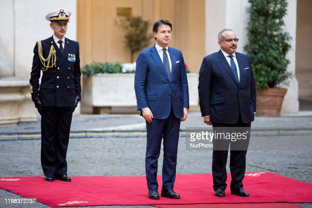 Italy's Prime Minister Giuseppe Conte and Bahrain's Crown Prince Salman bin Hamad bin Isa Al Khalifa stand during a welcoming ceremony at Chigi...