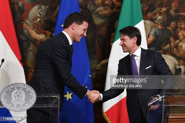 Italy's Prime Minister Giuseppe Conte and his Dutch counterpart Mark Rutte shake hands during a joint press conference following their meeting on...