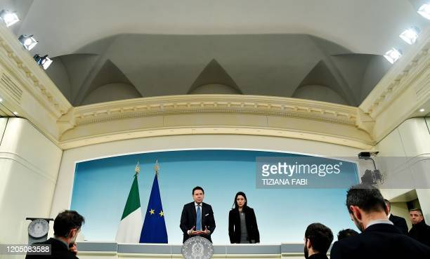 Italy's Prime Minister Giuseppe Conte and Italy's Public Education Minister Lucia Azzolina speak during a press conference held at Rome's Chigi...