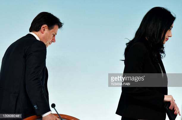 Italy's Prime Minister Giuseppe Conte and Italy's Public Education Minister Lucia Azzolina leave after giving a press conference held at Rome's Chigi...