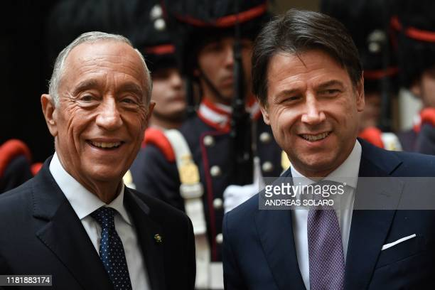 Italy's Prime Minister Giuseppe Conte and Portugal's President Marcelo Rebelo de Sousa pose during a welcoming ceremony upon Sousa's arrival for...