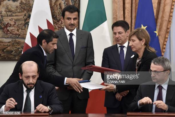 Italys Prime Minister Giuseppe Conte and Qatar's Sheikh Tamim bin Hamad al-Thani attend a contract signing ceremony following their meeting at Villa...