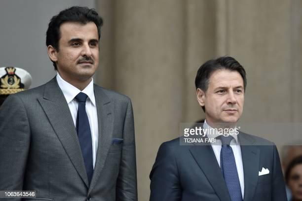 Italys Prime Minister Giuseppe Conte and Qatar's Sheikh Tamim bin Hamad al-Thani stand at attention upon al-Thani's arrival for their meeting at...