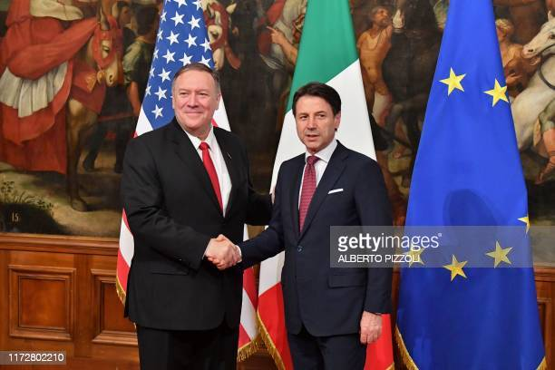 Italy's Prime Minister Giuseppe Conte and US Secretary of State Mike Pompeo shake hands during their meeting on October 1 2019 at Palazzo Chigi in...