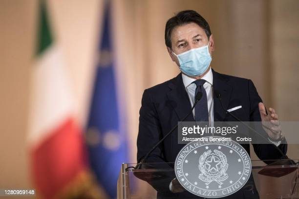 Italy's Prime Minister Giuseppe Conte announces new safety measures following a national surge of COVID-19 infections during a press conference at...