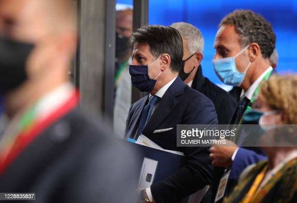 Italy's Prime Minister Giuseppe Conte departs after the first day of a European Union summit at The European Council Building in Brussels on October...