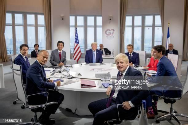 Italy's Prime Minister Giuseppe Conte, European Council President Donald Tusk, Japan's Prime Minister Shinzo Abe, US President Donald Trump,...