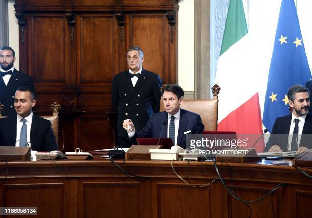 Italy's Prime Minister Giuseppe Conte flanked by Italy's Foreign Minister Luigi Di Maio and Italy's Secretary of the Council of Ministers Riccardo...