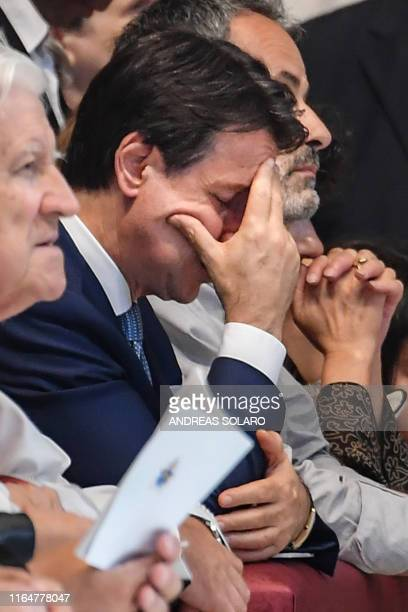 Italys Prime Minister Giuseppe Conte gathers his thoughts during a Pope's funeral mass for late Italian Cardinal Achille Silvestrini on August 30,...