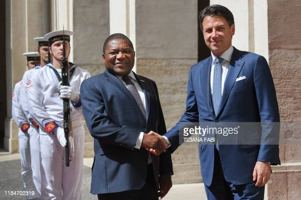Italys Prime Minister Giuseppe Conte greets Mozambique's President Filipe Nyusi upon his arrival for their meeting on July 9, 2019 at Palazzo Chigi...