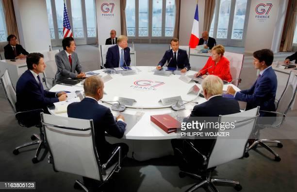 TOPSHOT Italy's Prime Minister Giuseppe Conte Japan's Prime Minister Shinzo Abe European Council President Donald Tusk US President Donald Trump...
