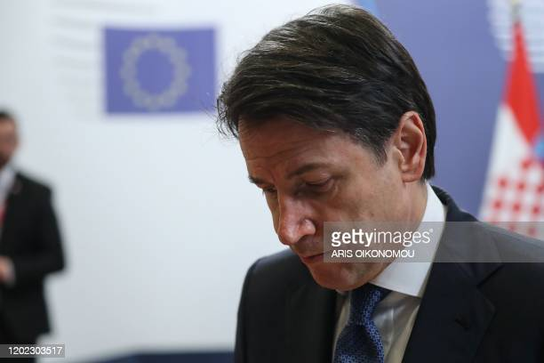 Italy's Prime Minister Giuseppe Conte leaves at the end of the special European Council summit in Brussels on February 21, 2020. - Time was called on...