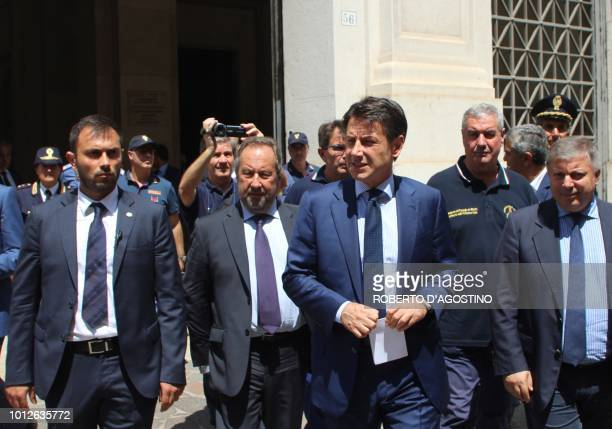 Italy's Prime Minister Giuseppe Conte leaves the prefecture of Foggia southern Italy on August 7 a day after a van smashed into a lorry killing 12...