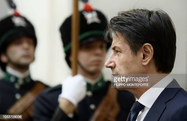 Italy's Prime Minister Giuseppe Conte looks on as he waits for his Libyan counterpart Fayez alSarraj before a meeting at the Palazzo Chigi in Rome on...